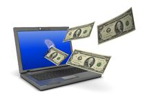 Laptop with money Stock Photos