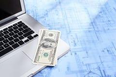 Laptop, money and blueprint Stock Photos