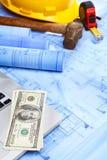 Laptop, money and blueprint Stock Photo