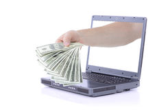 Laptop money Royalty Free Stock Images