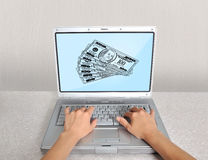 Laptop with money Royalty Free Stock Image