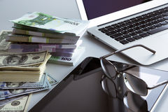 Laptop and money. Royalty Free Stock Images