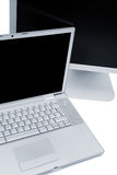 Laptop and the monitor. Modern laptop and the monitor on a white background stock image