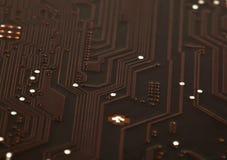 Laptop motherboard dark brown circuit background Stock Image