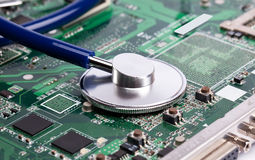 Laptop motherboard with stetoscope Stock Image