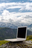 Laptop before mountain landscape Royalty Free Stock Images
