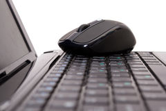 Laptop and mouse. On white Royalty Free Stock Images