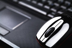 Laptop and mouse Stock Images