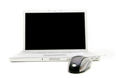 Laptop and mouse, focus on mouse Stock Image