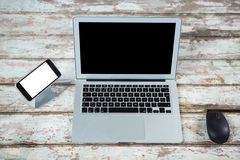 Laptop with mouse and smartphone Royalty Free Stock Image