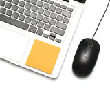 Laptop and mouse with sticky note Stock Image