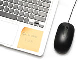 Laptop and mouse with sticky note Stock Photos