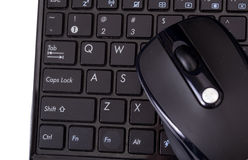 Laptop and mouse on white Royalty Free Stock Photography