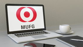 Laptop with MUFG logo on the screen. Modern workplace conceptual editorial 3D rendering Stock Image