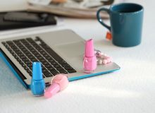 Laptop, mug and nail polish Royalty Free Stock Photography