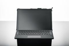 Laptop na czerni powierzchni Obraz Royalty Free