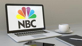 Laptop with National Broadcasting Company NBC logo on the screen. Modern workplace conceptual editorial 3D rendering Stock Photo