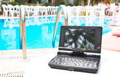 Laptop near pool Stock Images