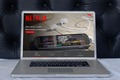 Laptop Netflix. LONDON, UNITED KINGDOM - June 02, 2015: Netflix web page on laptop screen in the house bedroom. Netflix is a global provider of streaming movies stock photos