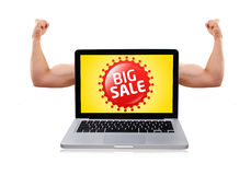 Laptop with nice muscular biceps and big sale sign. Isolated modern laptop with muscular biceps and big sale sign stock photos