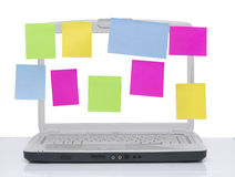 Laptop with note papers Stock Photo