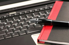 Laptop and notebook. Laptop keyboard and notebook with fountain pen Royalty Free Stock Images