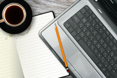 Laptop, notebook and coffee cup Stock Photos