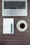Laptop, notebook and coffee cup on work desk Royalty Free Stock Image