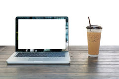 Laptop Notebook with iced coffee cup Royalty Free Stock Photography
