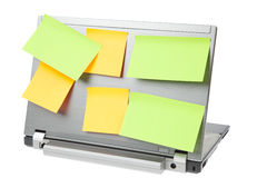 Laptop notebook isolated with postits on it. Laptop notebook isolated on white with post-its on it Stock Images