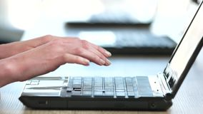 Laptop notebook keyboard typing. Inputing on keyboard, close up, side view stock video footage