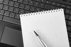 Laptop, notebook and pen Royalty Free Stock Photography