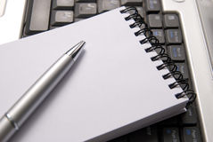 Laptop, notebook and a pen royalty free stock photos