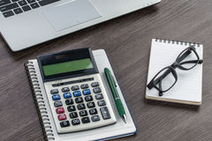 Laptop, notebook and pen with calculator on the desk Stock Photo
