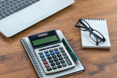 Laptop, notebook and pen with calculator on the desk Royalty Free Stock Photography
