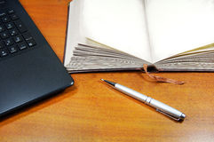 Laptop, notebook and pen Stock Image