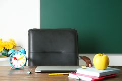 Laptop, notebooks and alarm clock Stock Photography