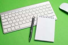 Keyboard with notepad, mouse, black pen and notebook stock photography