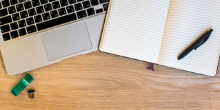 Laptop and Notepad with pen top view on the background Royalty Free Stock Photography