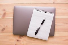 Laptop, notepad and pen Royalty Free Stock Image
