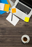 Laptop, notepad and tea cup Stock Image