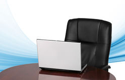 Laptop and office chair Stock Photography