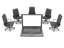 Laptop and office chairs Stock Photo
