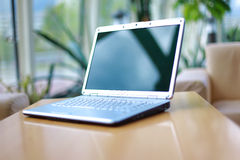 Laptop on office desk stock image