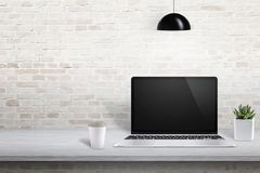 Laptop on office desk with free space on left side for text, picture frame or product presentation Stock Photography