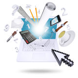 Laptop and office supplies Stock Photography
