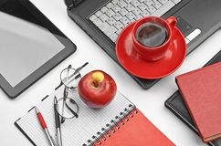 Laptop and office supplies on white Royalty Free Stock Photo
