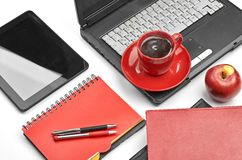 Laptop and office supplies on white Royalty Free Stock Image