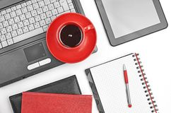 Laptop and office supplies on white Royalty Free Stock Images