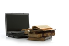 Laptop and old book Stock Photo